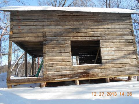 Example of a log cabin that is being reconstructed